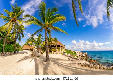 Amazing seascape with coastline, beach and palms in Xcaret park in Mexico