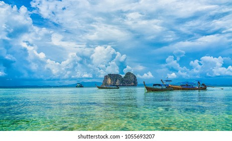 Amazing seascape with crystal clear sea water, rock island and blue sky background. Holiday paradise