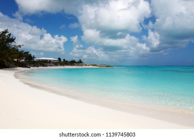 Amazing secluded and solitaire bay with clear and turquoise water and an incredible white sand beach. Exuma island, Bahamas