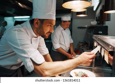 Amazing Service. Chef cook checking the order at the restaurant kitchen