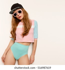 Amazing sexy brunette model skateboard style cap, beauty swag style, Tomboy fashion in trendy pink glasses and clothing style