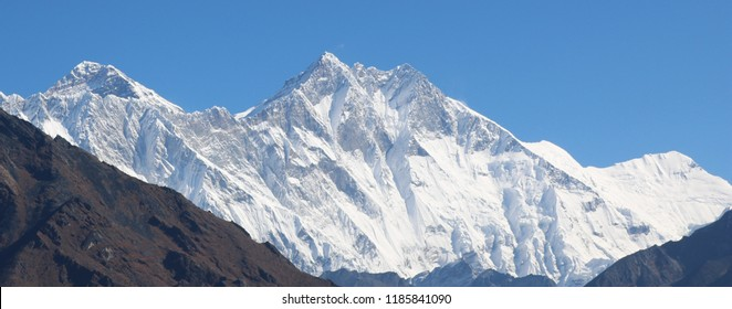 Amazing Shot of Panoramic view Nepalese Himalayas mountain peaks covered with white snow attract many climbers, some of them highly experienced mountaineers