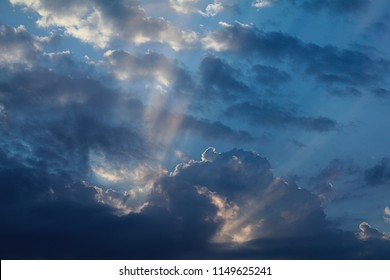 Amazing sky with clouds and a lot of beautiful sun beams