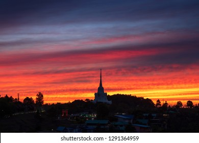 Amazing sky of sunrise at KhaoKho in Phetchabun province, Thailand. Beautiful and colorful sky.  Sunset over the Kanchanaphisek Phra Chedi or Phraborommathat pagoda at Khaokho, Phetchabun , Thailand.