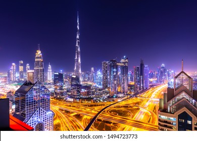Amazing skyline cityscape with illuminated skyscrapers. Downtown of Dubai at night, United Arab Emirates.