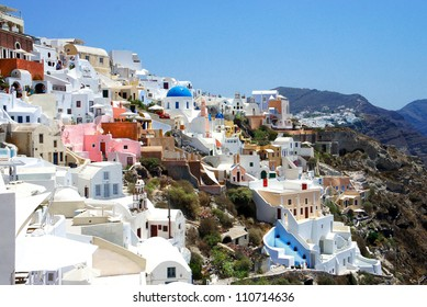Amazing small white houses of Santorini, summer sunny day