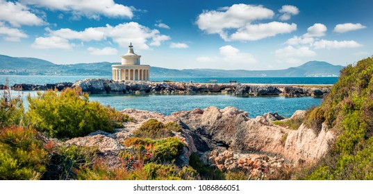 Amazing spring view of Saint Theodore Lantern. Sunny morning landscape of Argostoli Vilagito Torony Nature Preserve. Beautiful outdoor scene of Kefalonia island, Argostoli town, Greece, Europe.