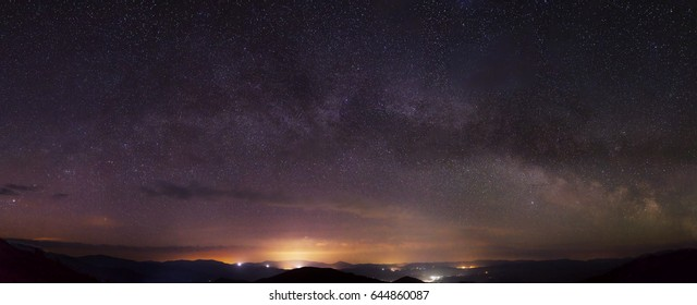 amazing star night with milky way galaxy over city lights