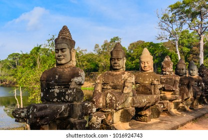 The amazing stone sculptures (giants and devils) with terrible faces in the South Gate of Angkor Thom complex (Thma Bay Kaek). Siem Reap, Cambodia