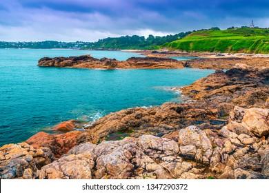 Amazing summer landscape, stunning ocean coastline with colorful granite rocks and fantastic beach, Perros-Guirec, Brittany region, France, Europe