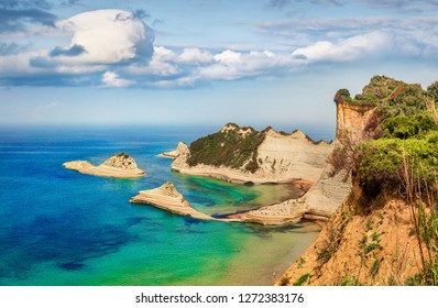 Amazing summer view of Cape Drastis thematic park. Fantastic morning seascape of Ionian sea. Attractive outdoor scene of Corfu island, Greece, Europe. Beauty of nature concept background.