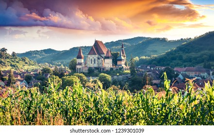 Amazing summer view of fortified Church of Biertan, UNESCO World Heritage Sites since 1993. Impressive morning scene of Biertan town, Transylvania, Romania, Europe. Traveling concept background.