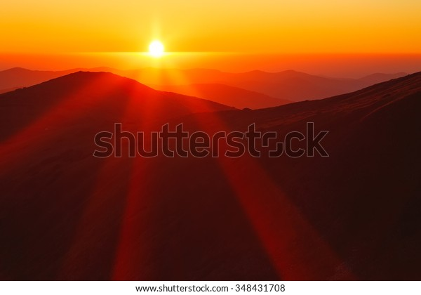 Amazing sun rays in a beautiful morning sunrise landscape, Carpathians.