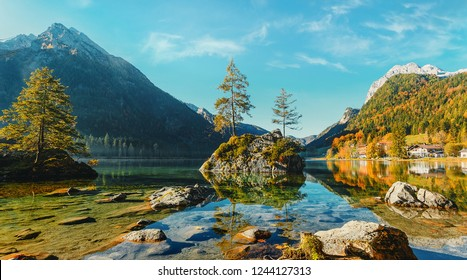 Amazing sunny landscape at famouse lake Hintersee. popular travel and hiking destination. Wonderful Summer Scene with Calm Fairytale Lake under sunlight. Autumn natural scene. nature Background.