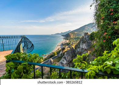 Amazing sunny mediterranean coast viewed from beautiful wrought iron balcony in Sicily, Italy