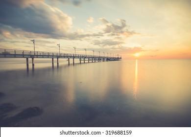 Amazing Sunrise at the beach, Machalinki Poland .Vintage sunrise seascape. Polish seashore.