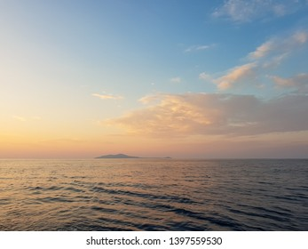 Amazing sunrise with beautiful red and yellow colors at the horizon of the Adriatic sea, close to Dubrovnik, on a sailing yacht at the coast of the national park of Mljet, croatia