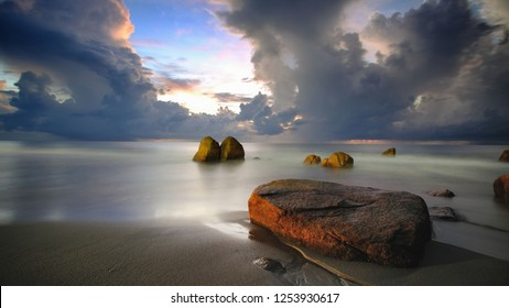 Amazing Sunrise with Beautiful Rocks Formation at Teluk Cempedak Beach, Pahang,Malaysia.