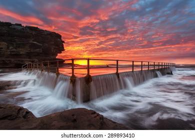 Amazing sunrise at north curl curl rock pool, Sydney rockpool.
