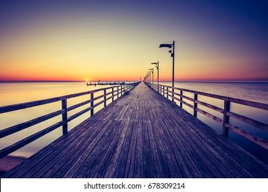 Amazing sunrise on the pier at the seaside. Gdynia Orlowo, Polan