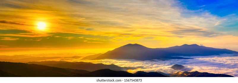 Amazing Sunrise Over Misty Landscape. Scenic View Of Foggy Morning Sky With Rising Sun Above Misty Forest. Rhodope Mountains. Xanthi Thrace, Greece. soft focus