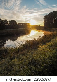 Amazing sunrise over the river Dyle in Mechelen, Belgium, during a misty early morning in September