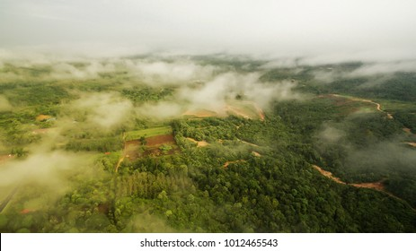 Amazing sunrise scenery at country side or village view from top with Thick Mist and cloud.Aerial Photography of sunrise at country side.Wallpaper and background concept.