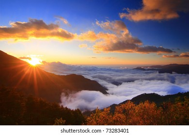 Amazing sunrise and sea of cloud with mountains and tree