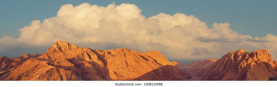Amazing Sunrise at Sinai Mountain, Beautiful dawn in Egypt, Beautiful view from the mountain. Toned Panorama.