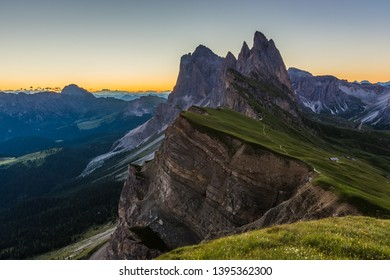 Amazing sunrise view of Odle Mountain range in Dolomites, Italy from Seceda summit