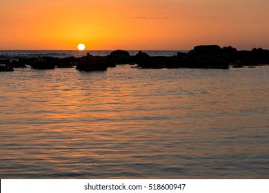 Amazing sunset at Ancon beach, Cuba, Caribbean side, with coral reef seen as the foreground.