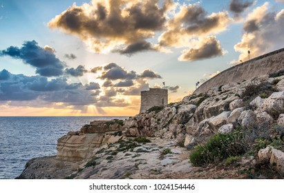 Amazing sunset in Blue Grotto with old Tower, Malta.