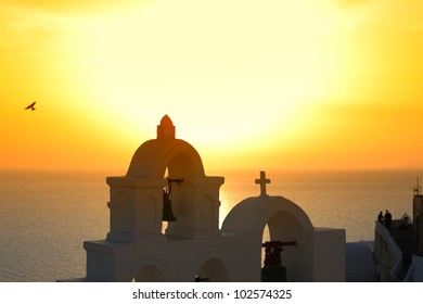 Amazing sunset with church at Oia village in Santorini island.