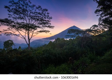 Amazing sunset foggy view of Mount Inerie Volcano in Flores island