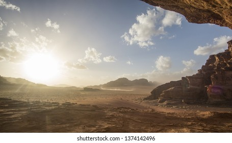 Amazing sunset at the Jordanian desert of Wadi Rum ,this breathtaking sunset will really blow your mind. Its stunning to see how the sun disappearing slowly behind those iconic mountains.