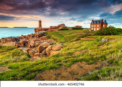 Amazing sunset with lighthouse of Ploumanach Mean Ruz in Perros-Guirec on Pink Granite Coast,Brittany,France,Europe