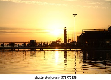 Amazing sunset in the Lisbon's port with golden sky upon the river Tajo's waters.