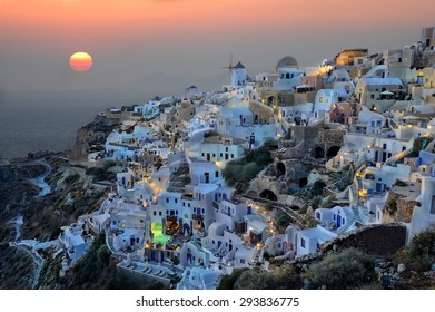 Amazing sunset at Oia village, Santorini island, Greece