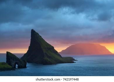 Amazing sunset on the Faroe islands (the rocks also known as Drangarnir gates)