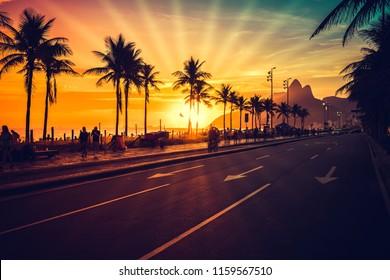 Amazing Sunset on Ipanema Beach with sun rays, Rio de Janeiro, Brazil