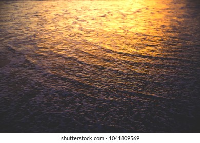 Amazing sunset on the ocean bay. Abstruct water background.