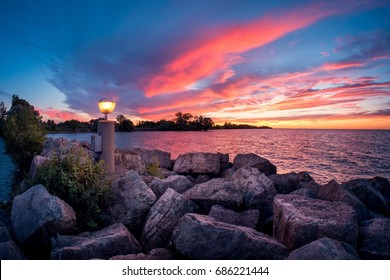 Amazing sunset with orange and pink sky on lake ontario