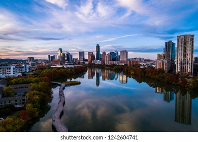 Amazing Sunset over Austin , Texas Mirrored reflections on Lady Bird Lake with pedestrian Bridge and perfect Skyline Cityscape at Golden hour sunset 2018