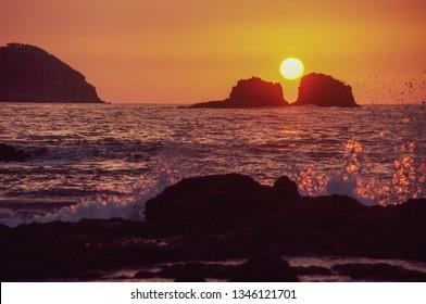 Amazing sunset over Manuel Antonio Public Beach in Puntarenas on Costa Rica
