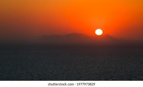 Amazing sunset over Oia and caldera of the Santorini island, Greece - Shutterstock ID 1977973829