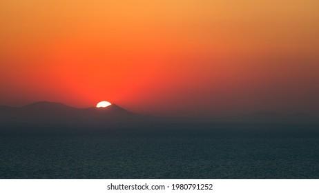 Amazing sunset over Oia and caldera of the Santorini island, Greece - Shutterstock ID 1980791252