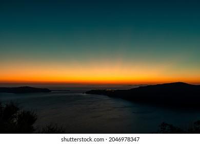 Amazing sunset over Oia and caldera of the Santorini island, Greece - Shutterstock ID 2046978347