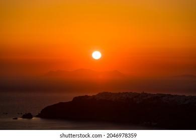 Amazing sunset over Oia and caldera of the Santorini island, Greece - Shutterstock ID 2046978359