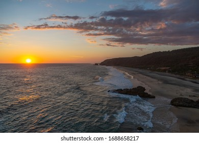 Amazing sunset over the pacific ocean from a hill in Punta Cometa, Mazunte, Mexico
