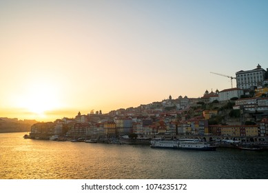 Amazing sunset over the Porto old town skyline on the Douro River, Portugal. Porto is the second largest city and famous tourist attraction in Portugal